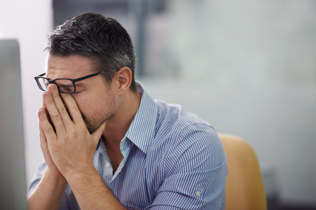 Man Feeling Overwhelmed